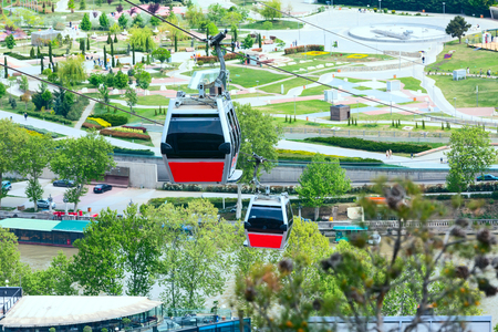 Tbilisi, Georgia red cable car cabins and aerial city skyline panoramic view Banco de Imagens - 88354362