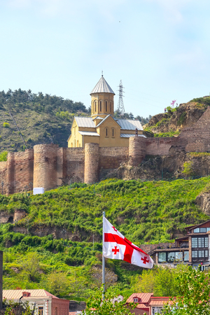 Narikala citadel and georgian flag in Old Town of Tbilisi, Republic of Georgia