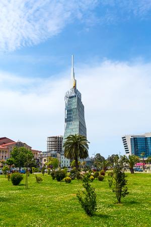 blu sky: Batumi, Georgia - May 2, 2017: City view with nice modern high buildings, street with palm trees at summer Black sea resort