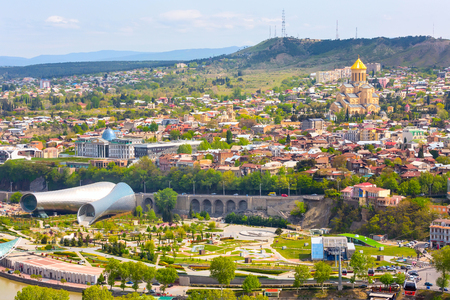 Tbilisi, Georgia aerial skyline with old traditional houses and Holy Trinity church or Tsminda Sameba Cathedral Banco de Imagens - 79322167