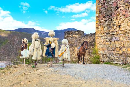 papakha: traditional Georgian shepherd dress, hat or papakha and coat of sheep fur, Ananuri, Georgia Stock Photo