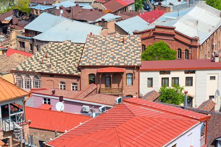 aerial view with houses with traditional wooden carving balconies of Old Town of Tbilisi, Republic of Georgia Banco de Imagens - 78876608
