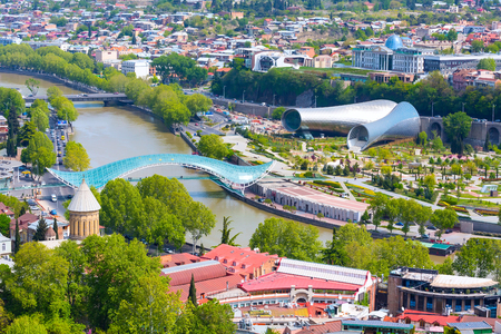 Tbilisi, Georgia aerial skyline with river, bridge and old traditional houses Banco de Imagens
