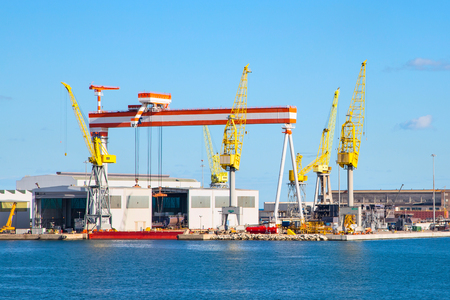 View at the harbor of Ancona with cranes and ships loaded Stock Photo