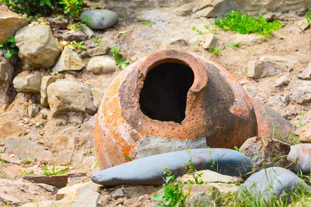old traditional georgian wine region symbol background with old big qvevri jug