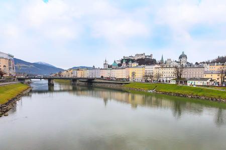 wolfgang: Salzburg, Austria - December 25, 2016: Historic city of Salzburg with Cathedral and Hohensalzburg Festung castle across Salzach river