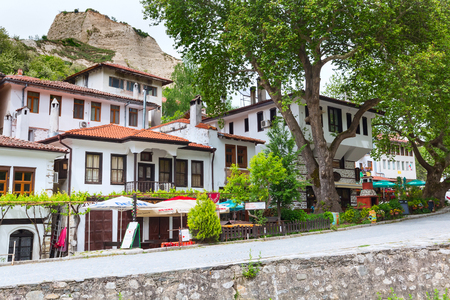 hotel building: Melnik, Bulgaria - May 11, 2017: Street view with traditional bulgarian houses with terrace from the Revival period in Melnik town, Bulgaria