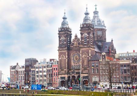 saint nicolas: Amsterdam, Netherlands - March 31, 2016: Basilica church of St. Nicholas in Amsterdam near railway station