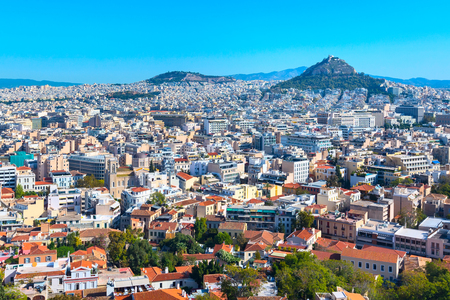 Panorama of Athens, Greece with houses and Lycabettus Hill against blue sky Banco de Imagens
