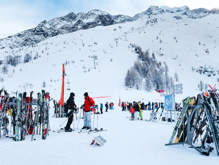 ski area: Chamonix, France - January 24, 2015: People skiing, pile of Skis and slopes view at Les Grands Montets ski area near Chamonix, France