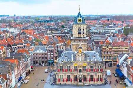 Delft, Netherlands - April 6, 2016: Aerial panoramic downtown street view with square and houses in Delft, Holland Editorial