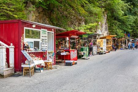 cavern: Rhodope, Bulgaria - July 29, 2015: Souvenir shops near entrance, Yagodinska cave, Rhodope, Bulgaria