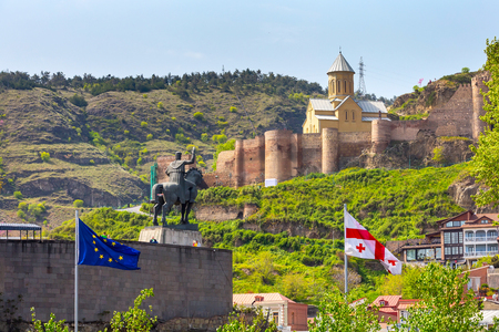 Tbilisi, Georgia - April 29, 2017: Narikala citadel and georgian flag in Old Town of Tbilisi, Republic of Georgia