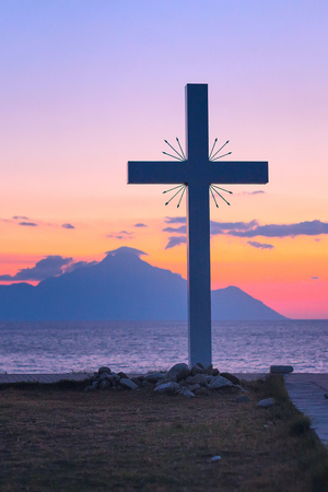 Silhouette of cross and mount Athos at sunrise or sunset and sea panorama in Greece Reklamní fotografie - 83650266