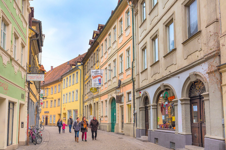 bayern old town: Bamberg, Germany - February 19, 2017: Bamberg city center street view with colorful houses and people