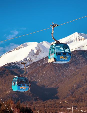 Bansko, Bulgaria - February 19, 2015: Bansko cable car cabin in Bansko, Bulgaria and snow mountain peaks at the background Publikacyjne