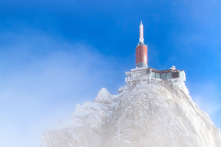 The mountain top station of the Aiguille du Midi in Chamonix, France in the fog