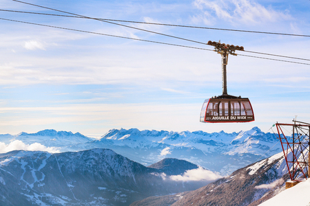 Chamonix, France - January , 28, 2015: Cable Car from Chamonix to the summit of the Aiguille du Midi and lift station high in the mountains Chamonix, France. Editorial