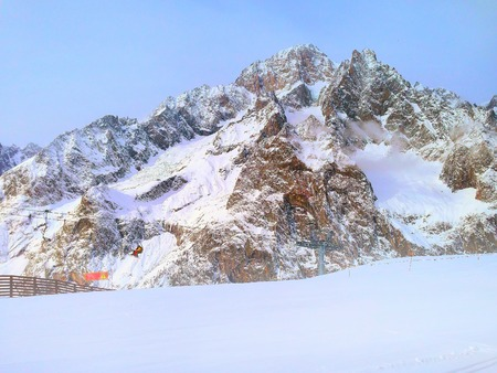 courmayeur: Winter snow mountains rocks in European Alps, ski lift and slope