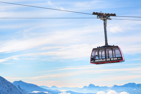 Chamonix, France - January , 28, 2015: Cable Car from Chamonix to the summit of the Aiguille du Midi and lift station high in the mountains Chamonix, France. Редакционное