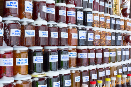 Kopaonik, Serbia - January 18, 2016: Chutney and honey jars made of various fruit types in specialty Serbian market