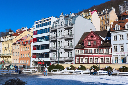 Karlovy Vary, Czech Republic - February 15, 2017: Street view, houses and people in famous spa town Editorial