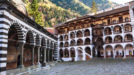 Rila monastery view with autumn mountain trees at background Stock Photo