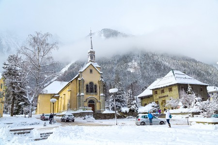 Chamonix, France - January 30, 2015: Church in Chamonix town, France, French Alps in winter and people