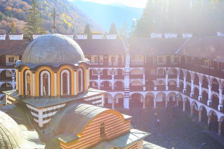 Rila, Bulgaria - October 27, 2017: Rila monastery view with autumn mountain trees at background Redakční