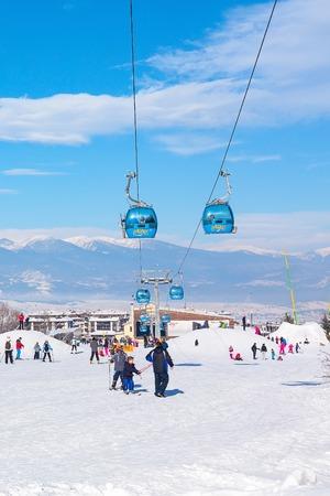 ski walking: Bansko, Bulgaria - January 13, 2017: Winter ski resort Bansko, ski slope, people skiing and mountains view Editorial