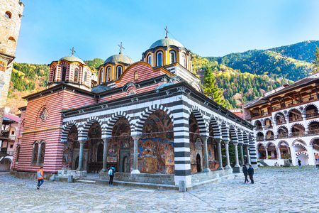 Rila, Bulgaria - October 27, 2017: Rila monastery view with autumn mountain trees at background Editorial