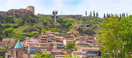 Panorama of Narikala fortress, traditional georgian houses and cable car funicular in Old Town of Tbilisi, Republic of Georgia Stock Photo