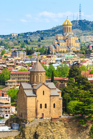 Tbilisi, Georgia aerial skyline with Metekhi and Tsminda Sameba churches