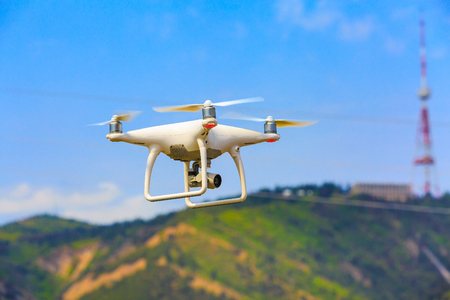 drone quadcopter close-up with digital camera in the sky over the city