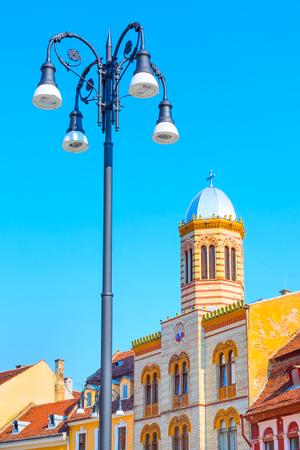 Orthodox Church at Piata Sfatului and street light in the center of Brasov, Romania