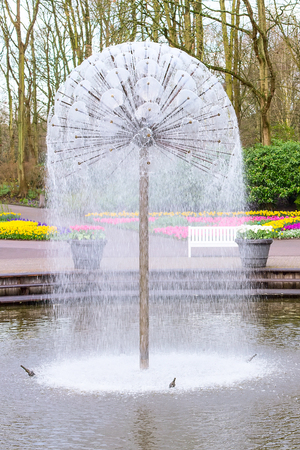 Lake and fountain in the spring flower garden park view Stock Photo