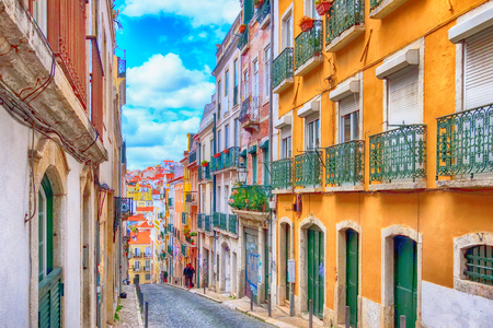 Lisbon, Portugal street perspective view with colorful traditional houses