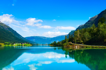 Norway Nordfjord fjord reflection panorama with forest mountains landscape and rural houses. Norwegian nature Stok Fotoğraf