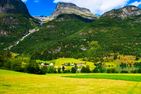 Norway Nordfjord fjord panorama with forest mountains landscape and rural houses. Norwegian nature Stock Photo