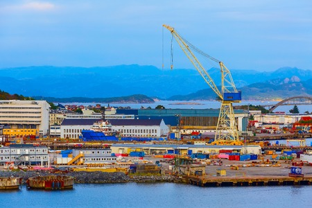 Heavy lifting crane vessel in cargo terminal of port harbour near Stavanger, Norway Stock Photo