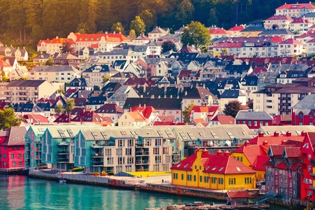 Norwegian scandinavian scenic landscape with fjord water and colorful traditional houses Imagens
