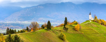 Autumn panorama with Saints Primus and Felician Church on top of hill in Slovenian countryside