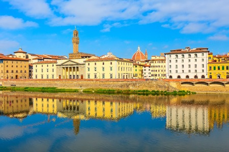 City view with Duomo Santa Maria Del Fiore dome and Palazzo Vecchio tower, houses and reflection in Arno river, Florence, Italy Фото со стока - 114892665