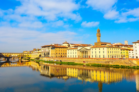 City view with Palazzo Vecchio tower, houses and Ponte Vecchio reflection in the river Arno, Florence, Italy Фото со стока - 114894975