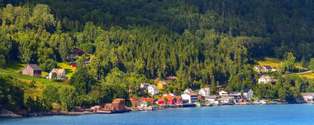 Norwegian village landscape with turquoise fjord water, mountains and colorful houses. Olden, Norway 版權商用圖片
