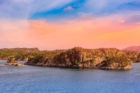 Norwegian colorful landscape with sunset over fjord and mountains, Norway