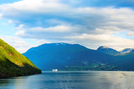 Norway colorful sunset Nordfjord fjord panorama with mountains landscape and cruise ship 版權商用圖片