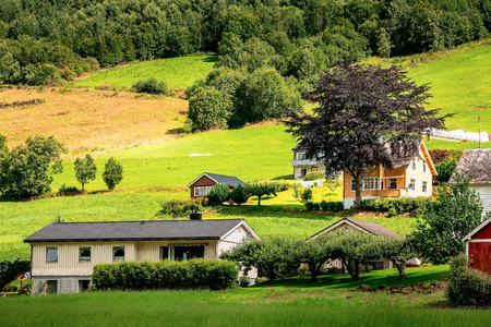 Norwegian village landscape, mountains and colorful traditional houses in Olden, Norway