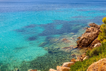 Nature blue turquoise clear sea water vacation background with and stone beach shore