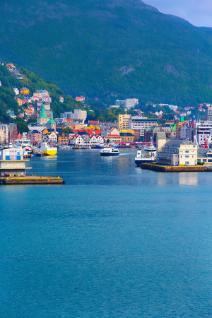 Bergen, Norway city view from the sea with Bryggen harbour, port and colorful traditional houses